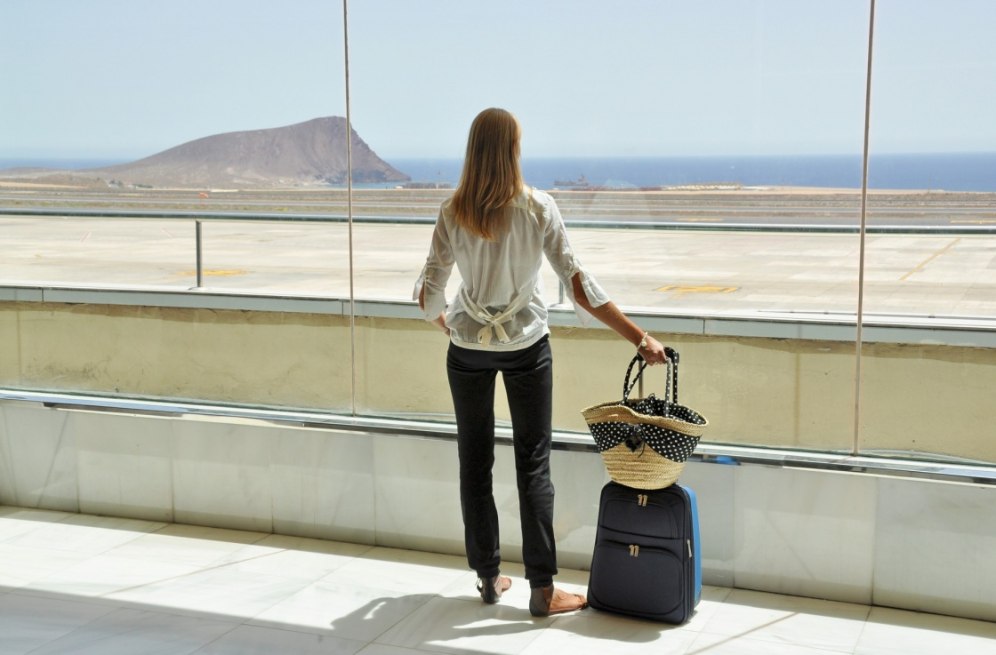 'Girl at the airport window looking to the Atlantic ocean. Tenerife, Canaries' - Teneriffa